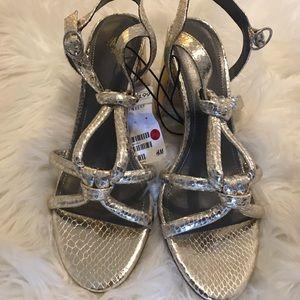 Metallic snakeskin heels